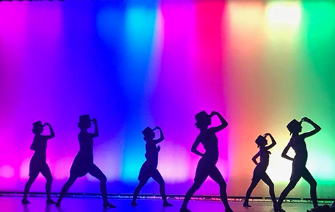 Dancers in silhouette from recitals