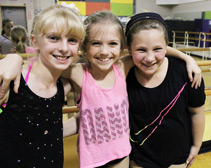 three friends at dance class in Northville, MI